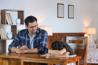 Portrait of a father daughter at home - Upset over her daughter studies: Family bonding