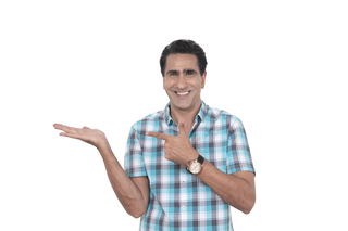A smart Indian man wearing a casual shirt and  pointing on the left side - white background, product showcase