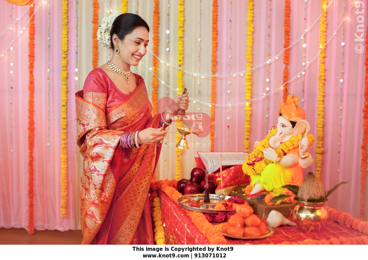 457a9b9a88 Indian woman offering aarti (pooja / puja) on Ganesh festival: Ganesh  Chaturthi