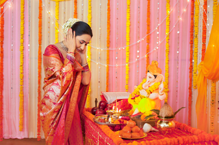 Beautiful Indian woman praying and taking blessings from God with power and faith - Hinduism