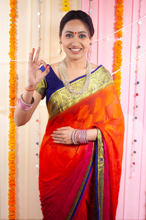 Young beautiful Indian woman posing for the camera with hand gesture sign - Festival