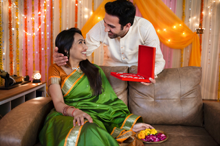 Potrait of a young romantic couple with gift box on festival or birthday or anniversary