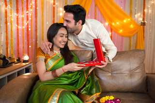 Romantic Indian husband surprising his wife with Diwali gift on the festival celebration