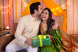 Indian wife surprising her husband with Diwali gift - Happy couple