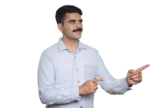 Happy young man with mustache pointing away at copyspace - White background Image