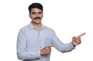 Smart Indian man in casual shirt pointing away at white background: lifestyle image
