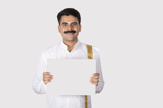 Image of a happy man holding a banner with both hands - facing towards the camera. Advertising concept, print ad concept