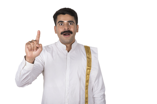 Portrait of a south Indian man looking shocked after winning the lottery - Winner concept, white background