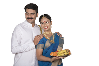 Beautiful south Indian couple  going to temple to pray - Stock image with white background