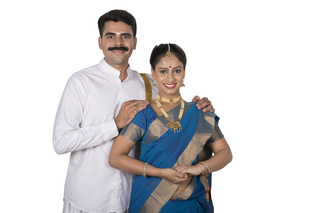 Portrait of a attractive happy south Indian couple in traditional dress