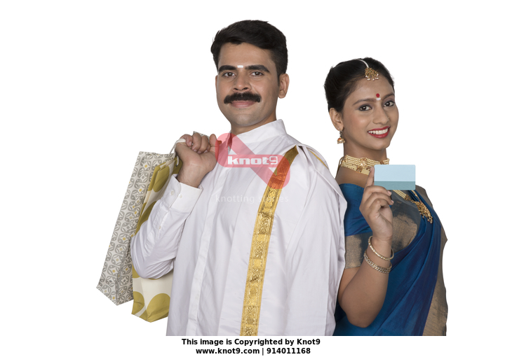 d69a8e2778 Smart south Indian couple shopping for Onam celebration, wearing  traditional clothes