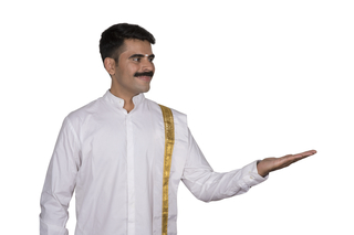 South Indian man in traditional outfit presenting a product - White background