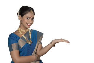 Portrait of a south Indian woman showing or presenting a product - pointing her palm on white background