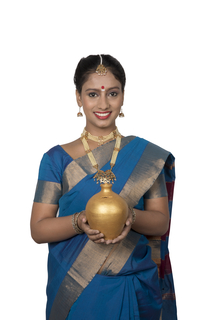 South Indian woman wearing silk saree is holding a piggy bank - saving money, finance concept (White background)