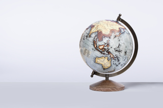 Closeup portrait of the world's globe on the white background