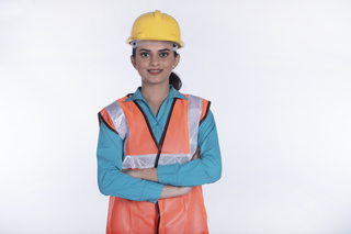 Young Indian civil engineer or architect posing towards the camera, white background - occupation concept