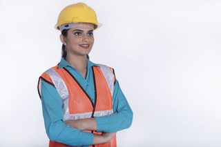 Portrait of woman civil engineer or architect looking sideways on white background - studio isolated
