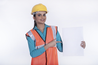 Smiling young business woman - architect holding an advertising banner. Isolated portrait