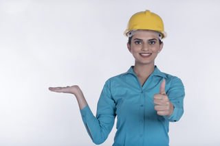 Happy architect woman displaying a construction model- Architecture