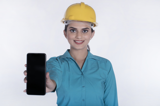 Portrait of a smart business woman showing mobile phone/smartphone - Architecture (White background)
