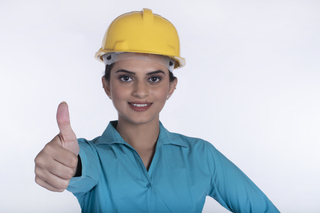 Successful female architect with thumbs up gesture - Business, architecture concept