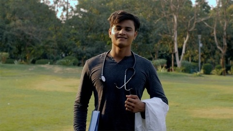 Young aspiring male doctor with a stethoscope on the neck standing in the park