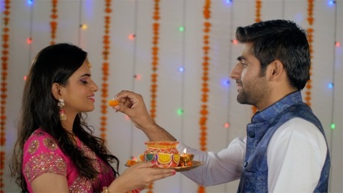 Good looking happy husband-wife celebrating their first Karwa Chauth together
