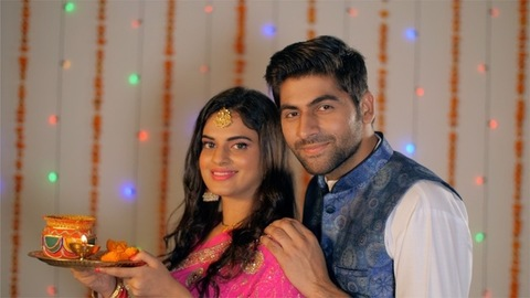 Attractive Indian husband-wife celebrating festivals together in traditional wear