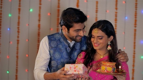 The newly-wed couple celebrating Indian festivals together in traditional wear