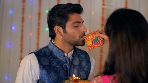 A modern newly-wed couple happily celebrating the Karwa Chauth festival together