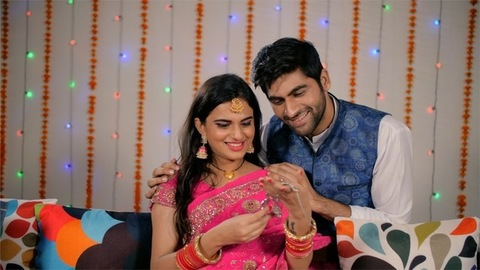 Newly Married Indian husband surprises wife with a necklace as a gift - Festival concept
