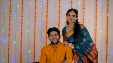 Handsome Indian husband happy to see his wife in traditional saree on Diwali