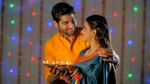 Young married couple happily celebrating Diwali together