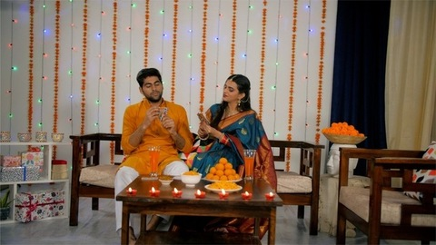 Attractive couple playing cards during Deepawali celebration - Indian festival