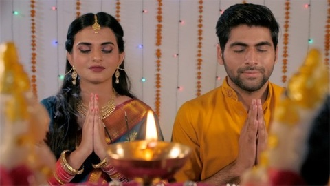 Modern Indian couple doing the traditional Diwali puja - the Hindu culture