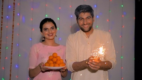 Husband-wife happily celebrating the festival of Diwali - Hindu festival