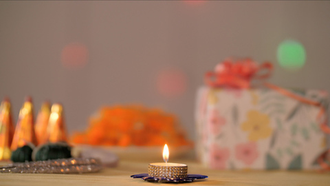 Decorative wax lamp kept with other Diwali props