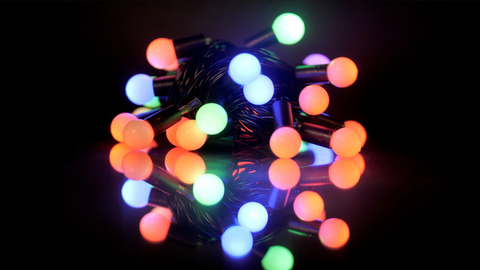 Christmas decorative glittering lights in the dark - celebration concept