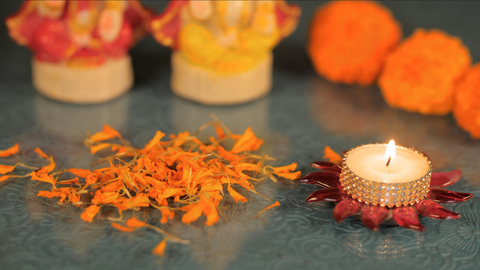 Orange marigold flower petals offered to God during the Diwali celebration