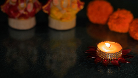 Lighted wax decorative Diya/candle for worship during Diwali celebration