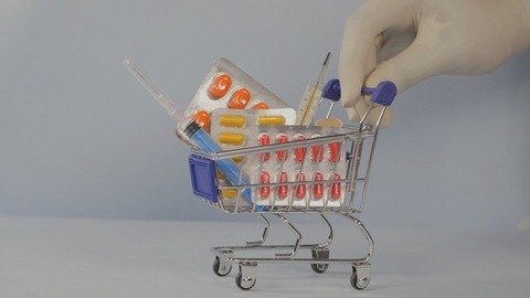 Healthcare and medical concept - a small trolley full of pharmaceutical things