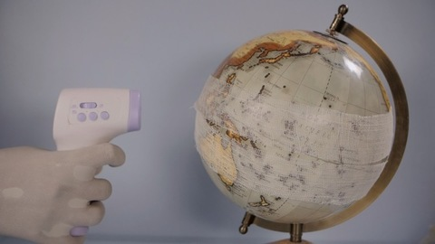 Earth globe with a white cotton bandage - Coronavirus spread around the world