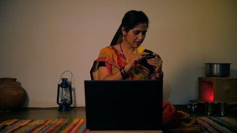 Village housewife putting card details of her new debit/credit card for online purchase