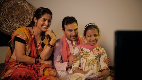 Indian village family watching their favorite TV serial together at home