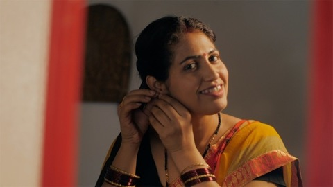 Happy traditional housewife in saree and mangalsutra getting ready