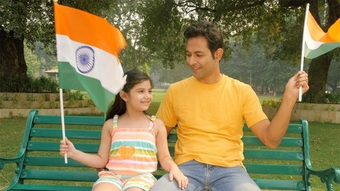 Father and daughter waving the Indian flag - Independence Day / Republic Day