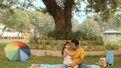 A small little child happily running towards her father in the park - fun moments