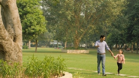 Urban father wearing shirt and jeans enjoying a leisure walk with his daughter