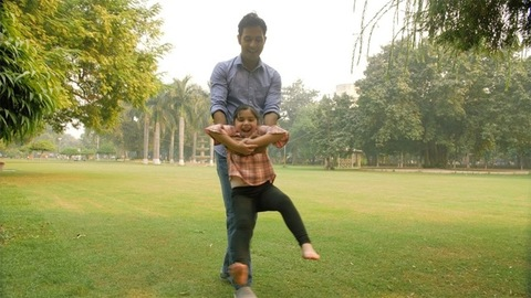 Father and daughter playing in a park - happy family kid fun moments concept