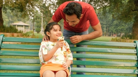 Loving father giving delicious ice cream to his daughter - happy family moments